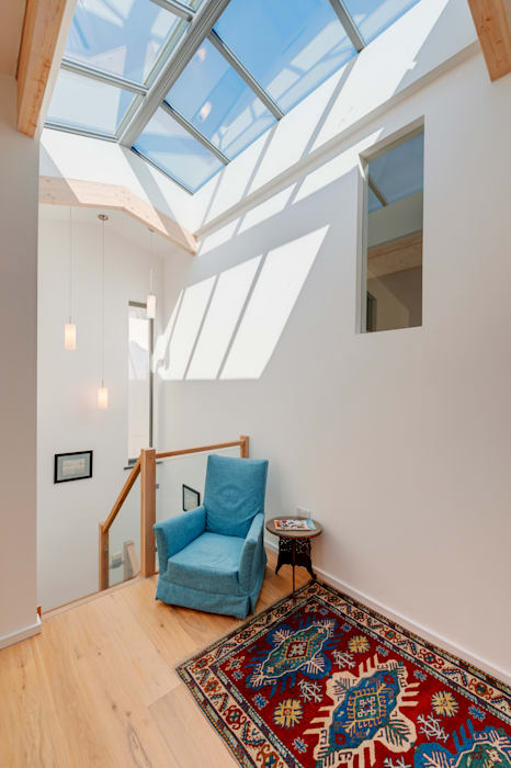 Couloir et hall d'entrée de style  par Trewin Design Architects
