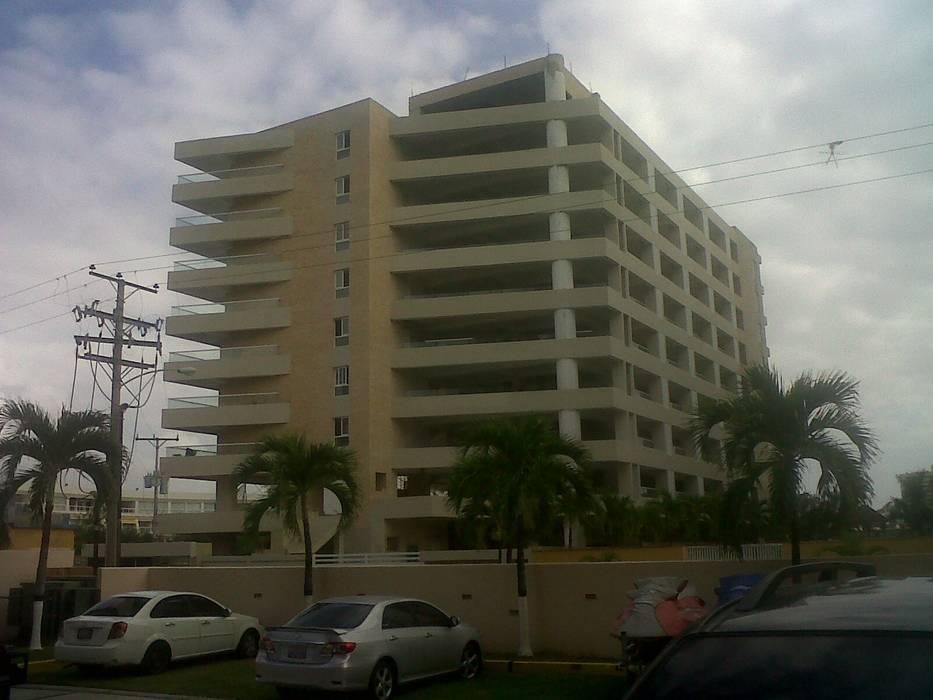 CONJUNTO RESIDENCIAL ABISAI SUITES Casas modernas de Grupo JOV Arquitectos Moderno Piedra