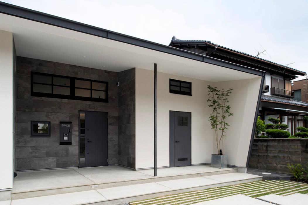 Casas modernas por Sakurayama-Architect-Design Moderno