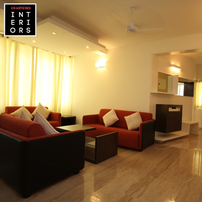 Living Room Designs:  Living room by Chartered Interiors ,