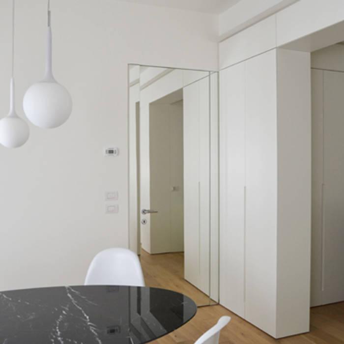PRANZO: Sala da pranzo in stile in stile Moderno di architetti:sabrina romani, cosimino casterini, stefania palanca