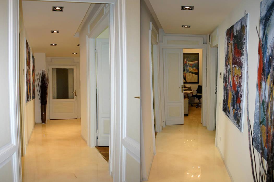 Ingresso e corridoio in resina con polvere di madreperla : Complessi per uffici in stile  di Fabio Carria