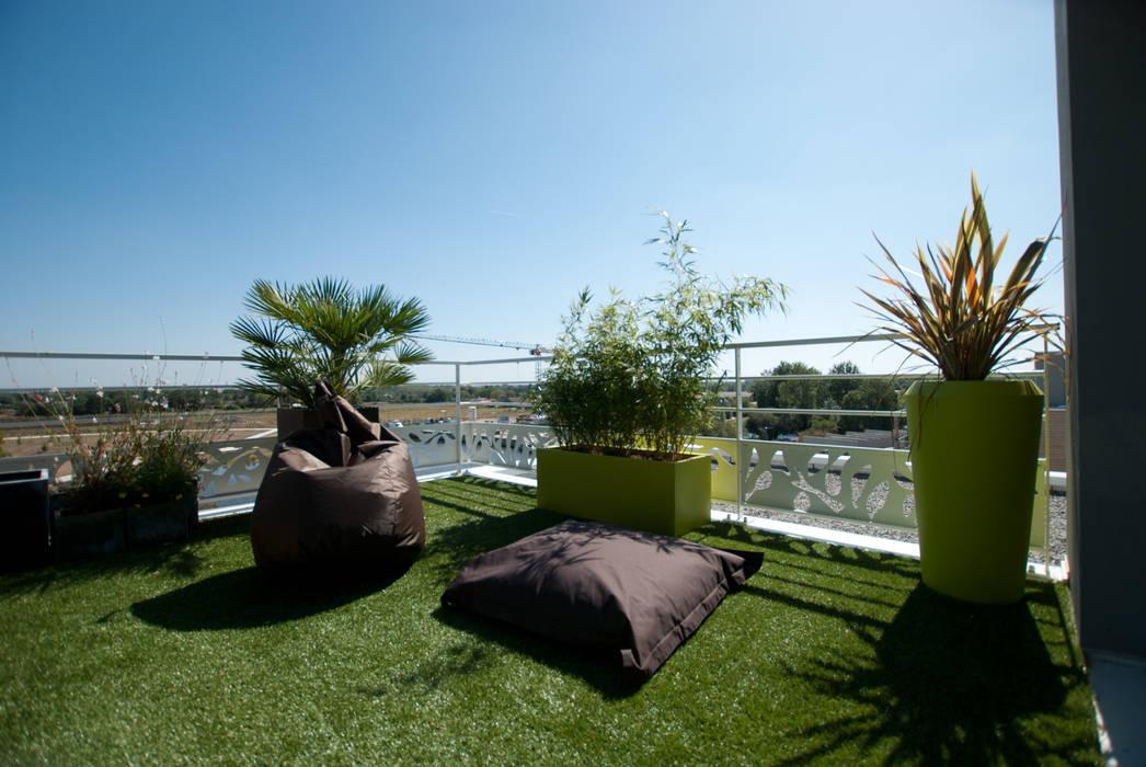 Terrazas de estilo  por Vertigo jardins, Moderno