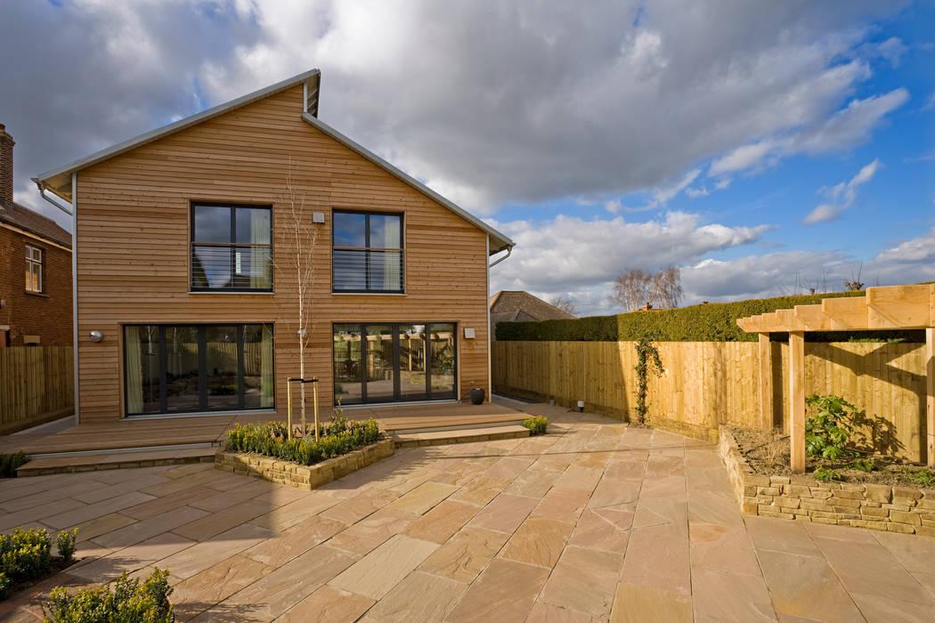 Casas de estilo  por Baufritz (UK) Ltd., Moderno