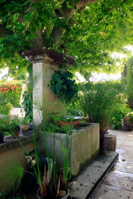 Jardin champêtre: Jardin de style  par CONCEPTUELLES PAYSAGE ET DECORATION