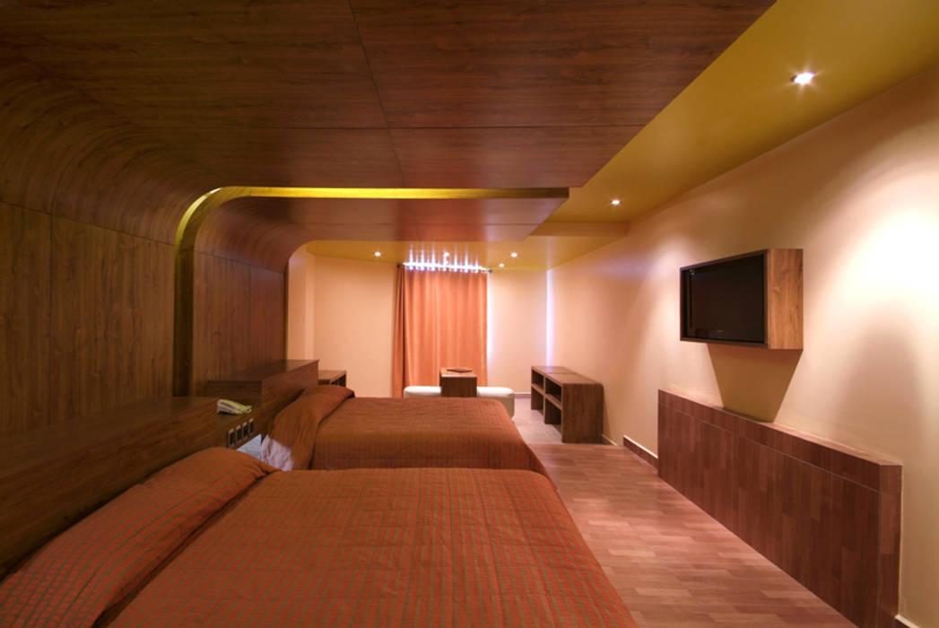 Hotel Ixtla : Recámaras de estilo  por DIN Interiorismo