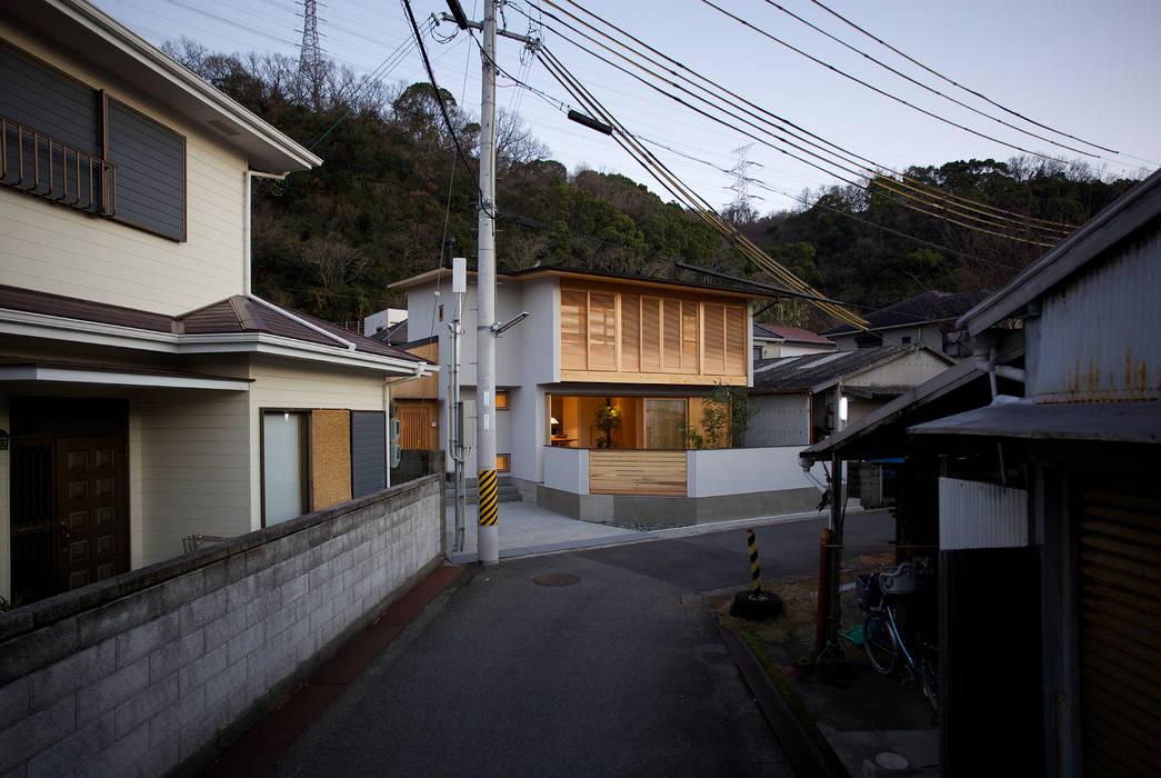 Дома в азиатском стиле от 辻健二郎建築設計事務所 Азиатский Дерево Эффект древесины