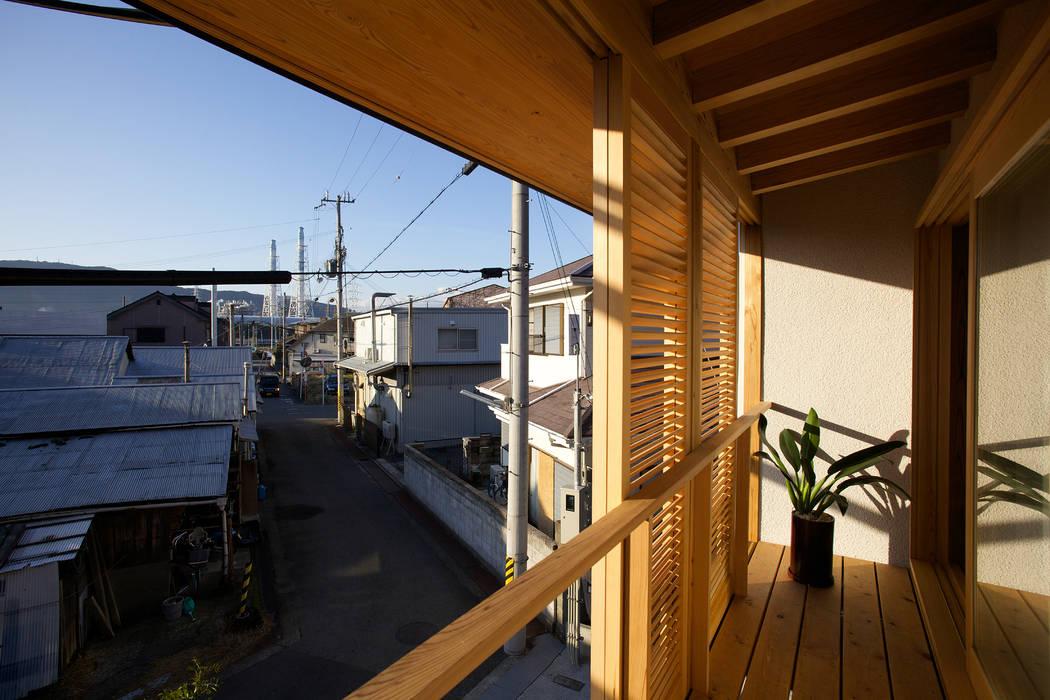 Дома в азиатском стиле от 辻健二郎建築設計事務所 Азиатский