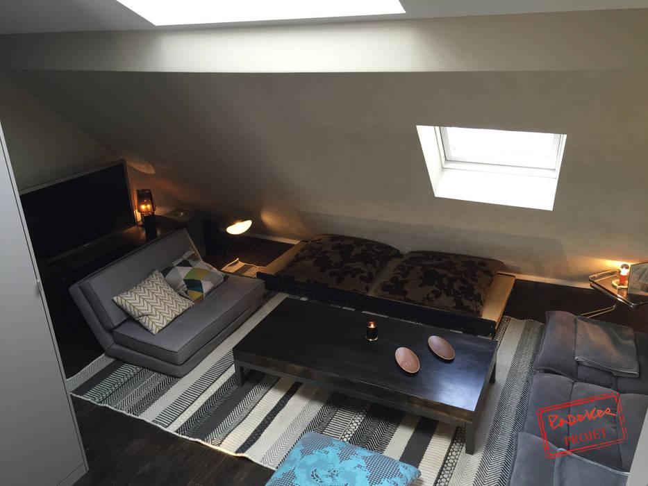 Appart sous les toits: Salon de style  par Padeker