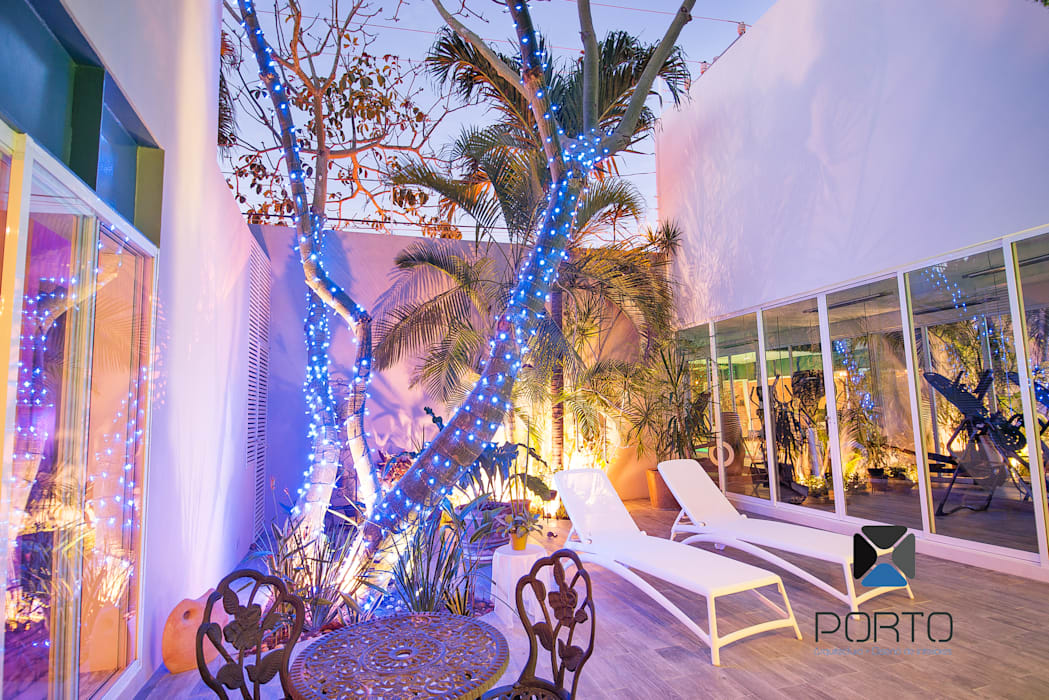 Garden by PORTO Arquitectura + Diseño de Interiores, Eclectic