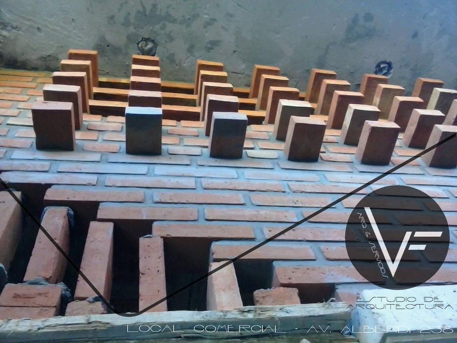 Locaux commerciaux & Magasin modernes par VF ESTUDIO Moderne Briques