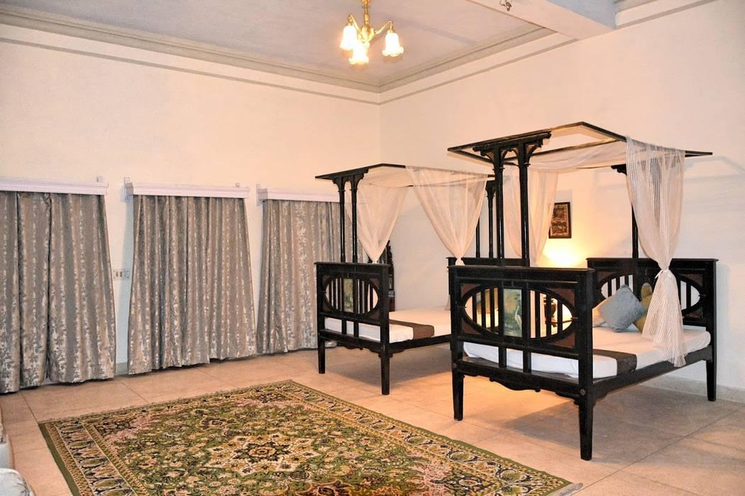 Unchagaon:  Bedroom by Studio Ezube
