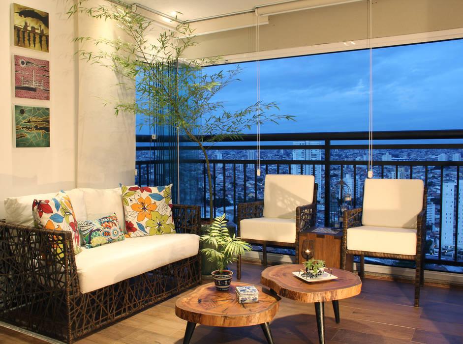 Apartamento MFCO Caravieri Cardoso Arquitetura Varandas, alpendres e terraços rústicos