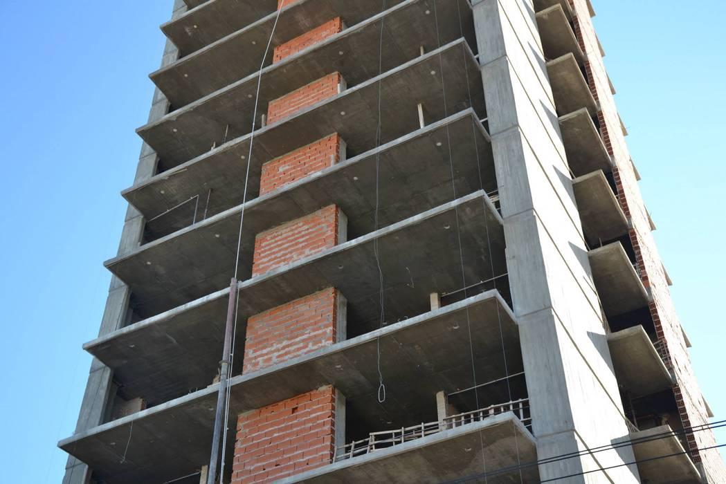 Obras en construcción:  de estilo  por Tueros Mora Arquitectos Asociados