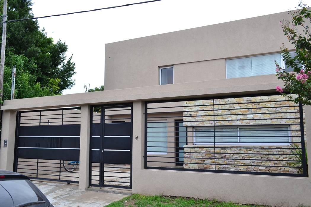 Frente : Casas de estilo  por epb arquitectura