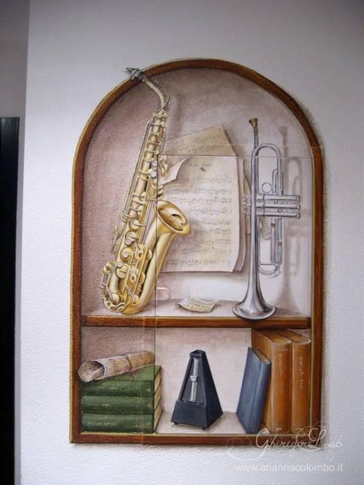 Nicchia con strumenti musicali : Pareti in stile  di Ghirigori Lab di Arianna Colombo