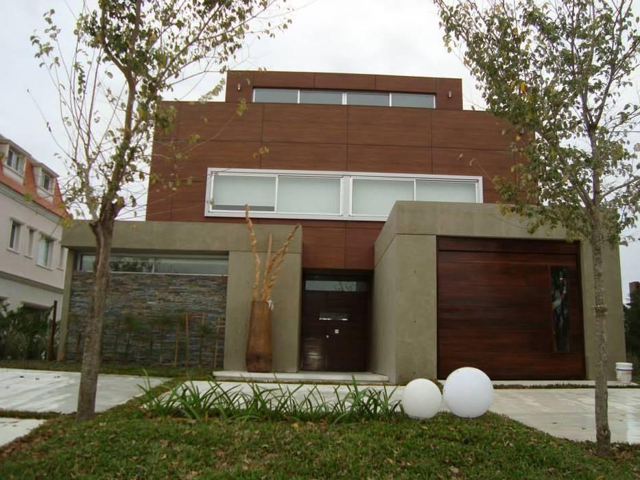 Casa C3: Casas de estilo  por Conformar S.R.L.,