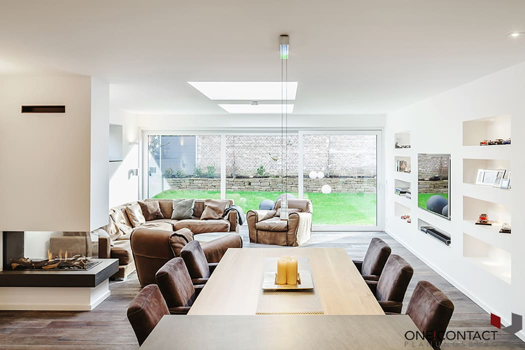 Living room by ONE!CONTACT - Planungsbüro GmbH,
