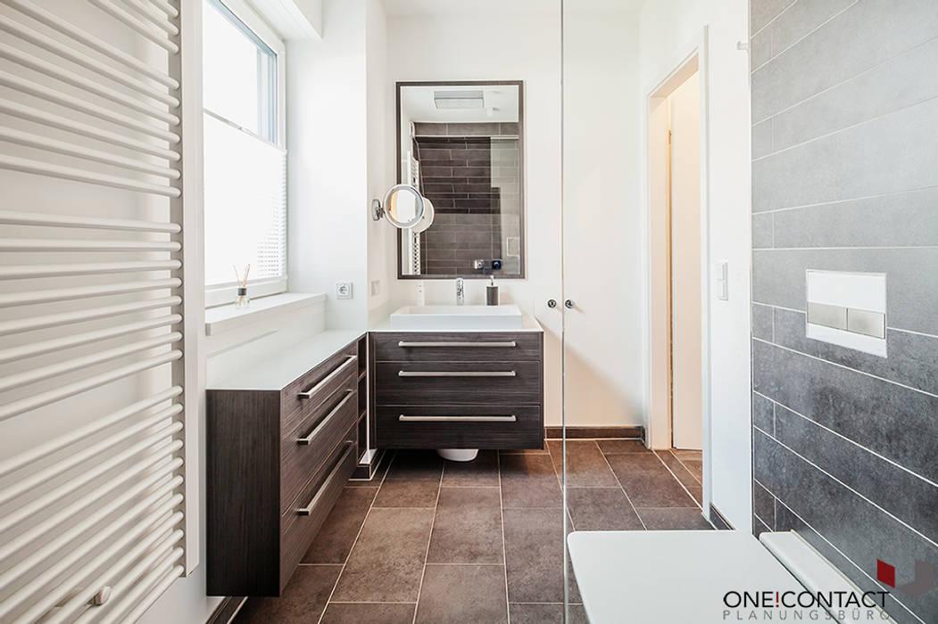 Casas de banho  por ONE!CONTACT - Planungsbüro GmbH