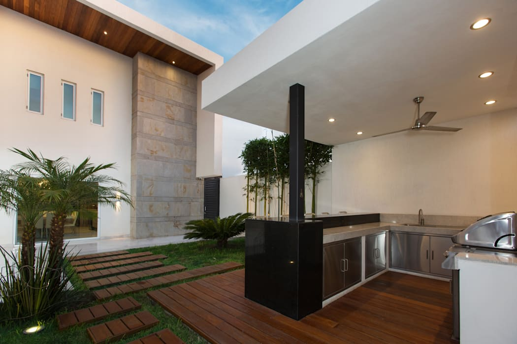 Casa CG: Jardines de estilo  por Grupo Arsciniest,
