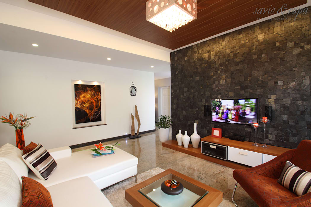 Living room:  Living room by Savio and Rupa Interior Concepts