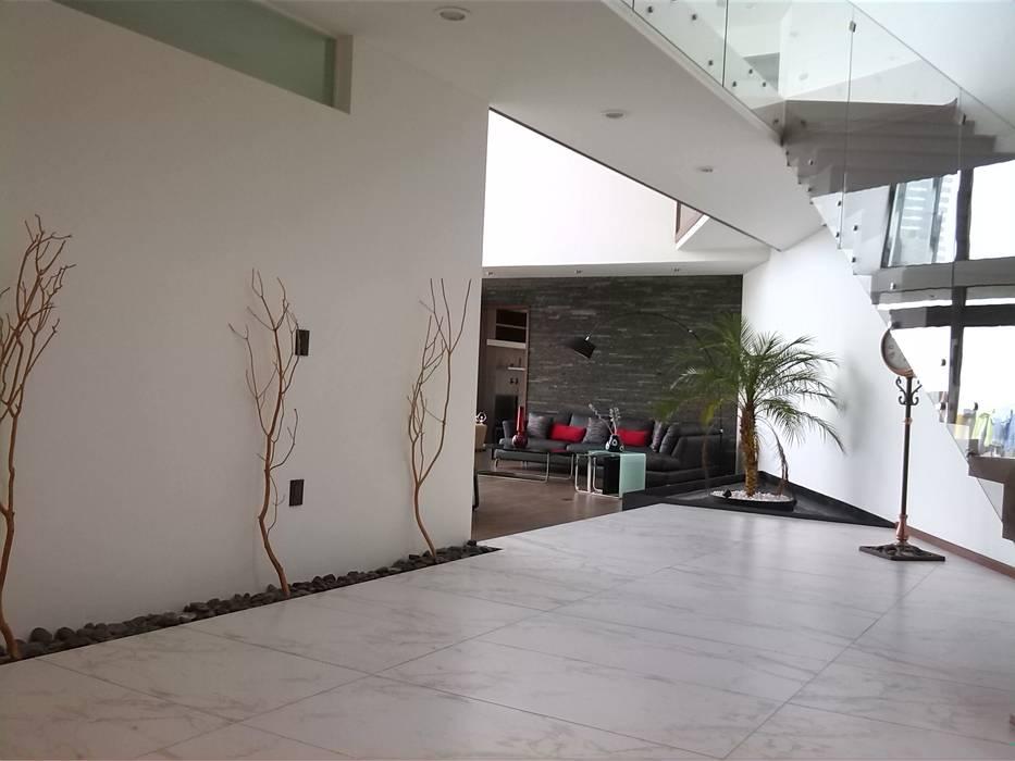 Коридор, прихожая и лестница в модерн стиле от homify Модерн Камень