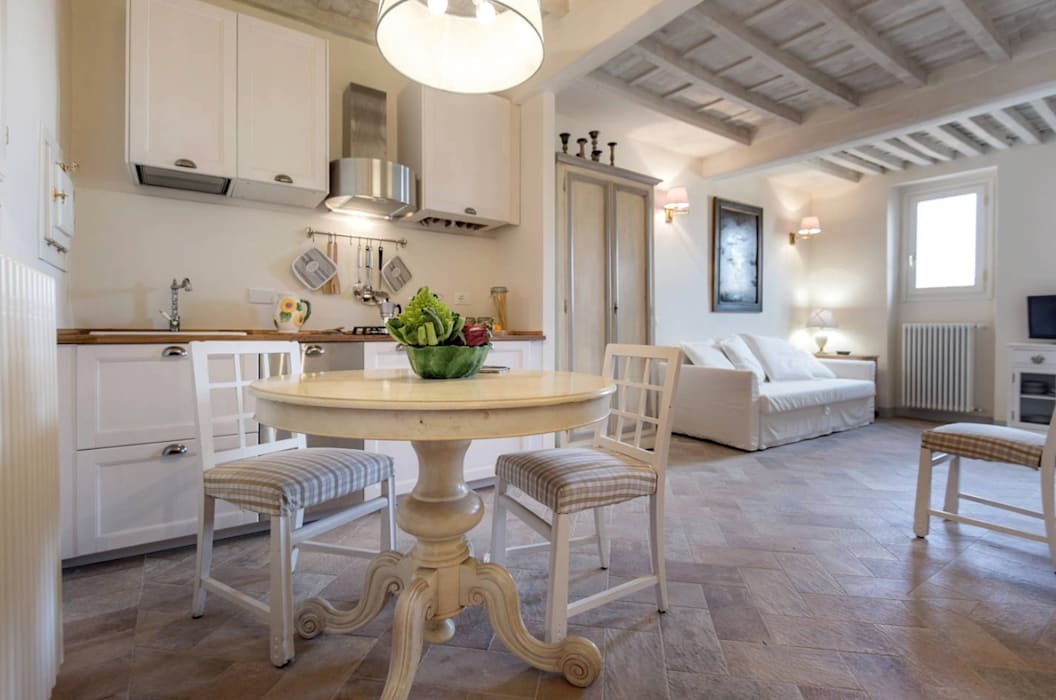 Rustic style dining room by STUDIO ARCHIFIRENZE Rustic