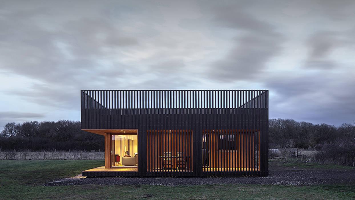 Дома в . Автор – ecospace españa, Модерн Дерево Эффект древесины