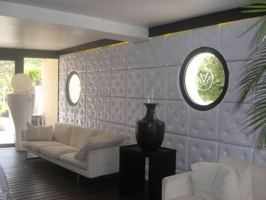 Revetement mural avec des panneaux capitonnés: Murs de style  par DONNA DESIGN