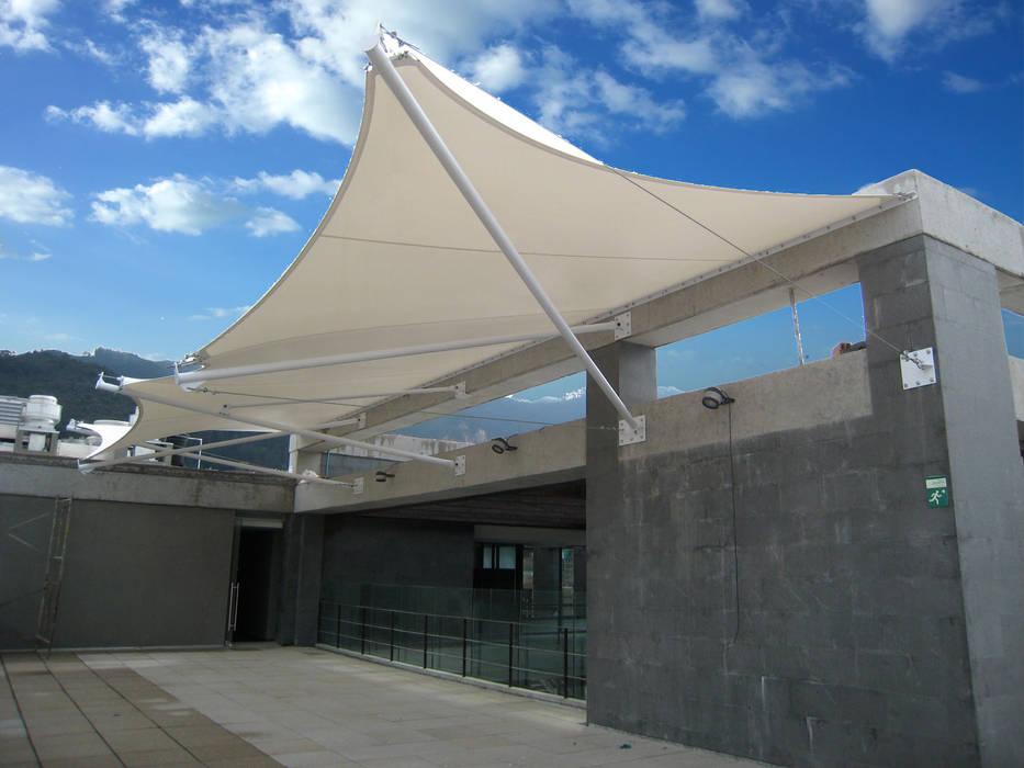 ::MEMBRANAS ARQUITECTONICAS - UNIVERSIDAD EL BOSQUE ::: Terrazas de estilo  por Diseños & Fachadas SAS