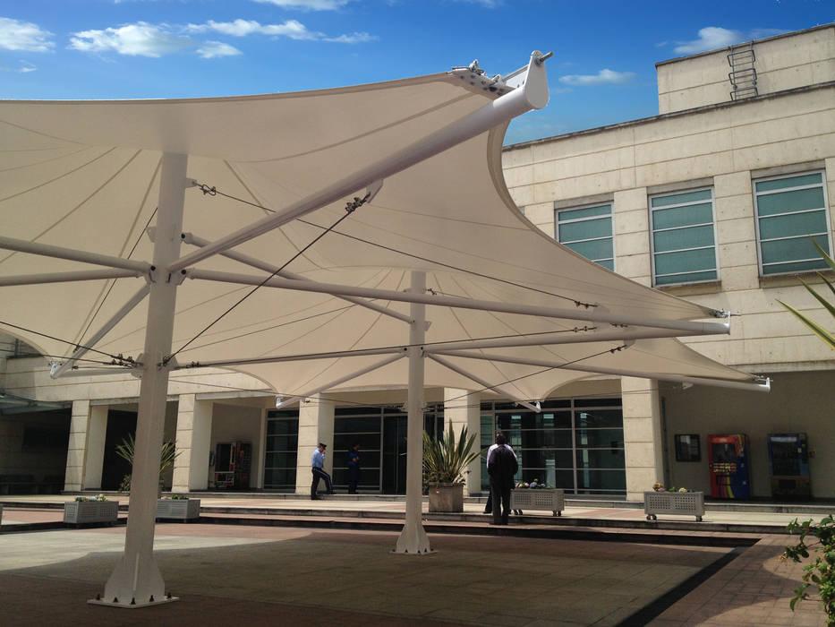 :: MEMBRANA ARQUITECTONICAS - BANCO DE LA REPUBLICA ::: Jardines de estilo  por Diseños & Fachadas SAS