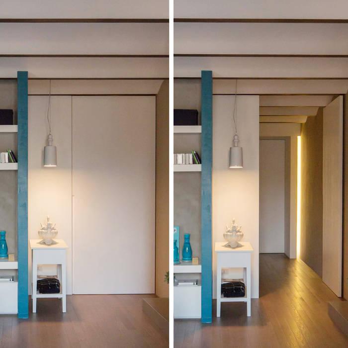 PORTA-PARETE: Soggiorno in stile in stile Moderno di Studio Perini Architetture