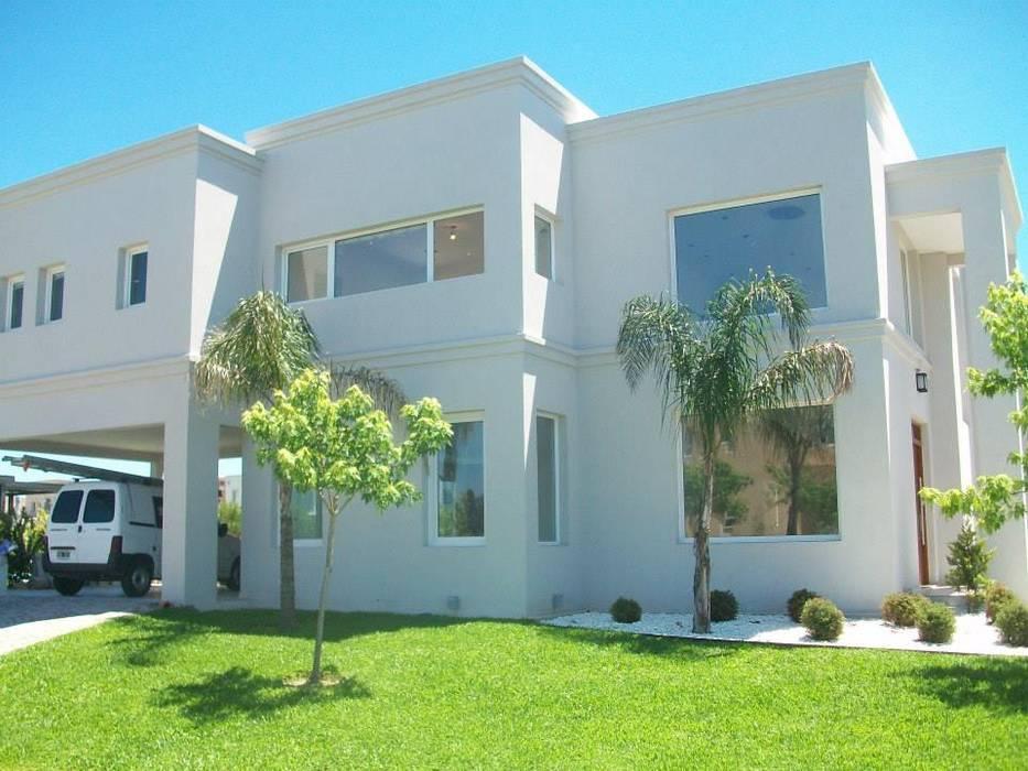 Vista lateral Casas clásicas de MOLEarquitectura Clásico Cuarzo