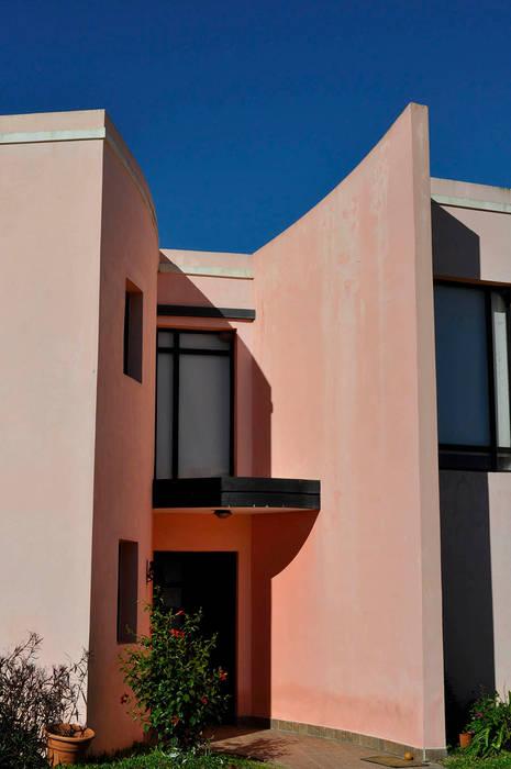 Casas de estilo clásico de AM estudios Clásico