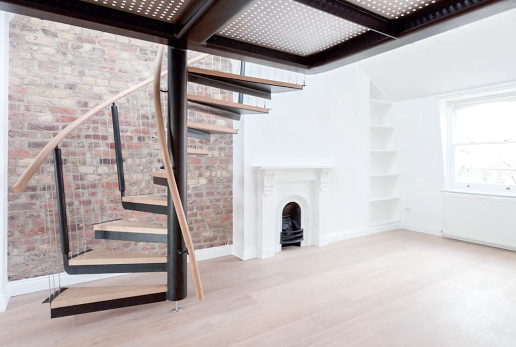 Spiral staircase to the mezzanine:  Corridor & hallway by Railing London Ltd