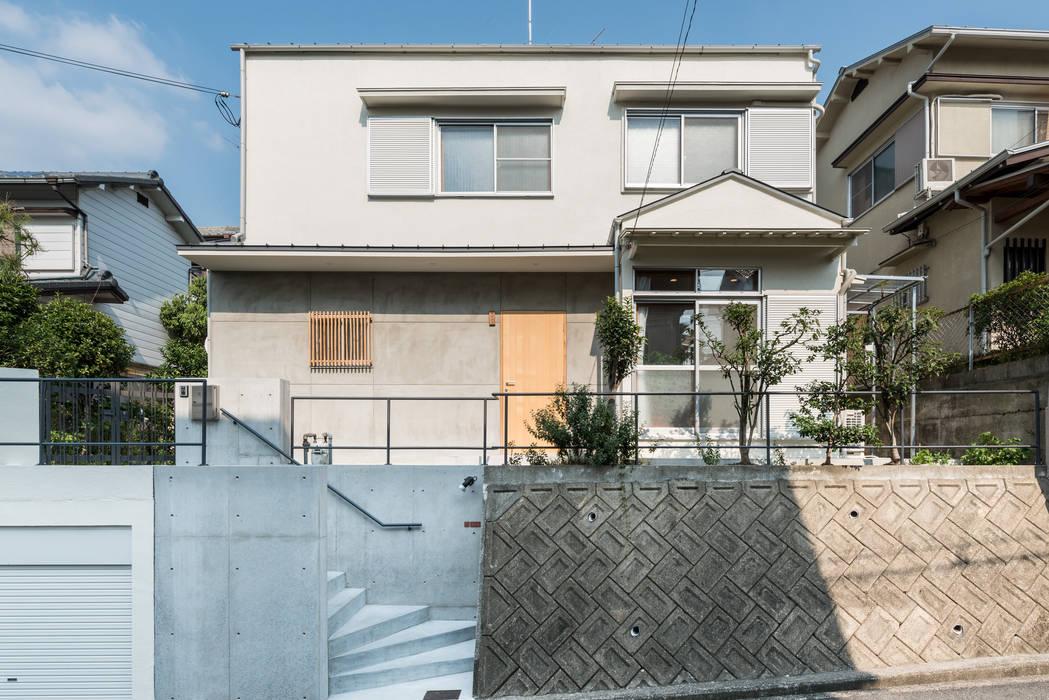 Eclectische huizen van coil松村一輝建設計事務所 Eclectisch