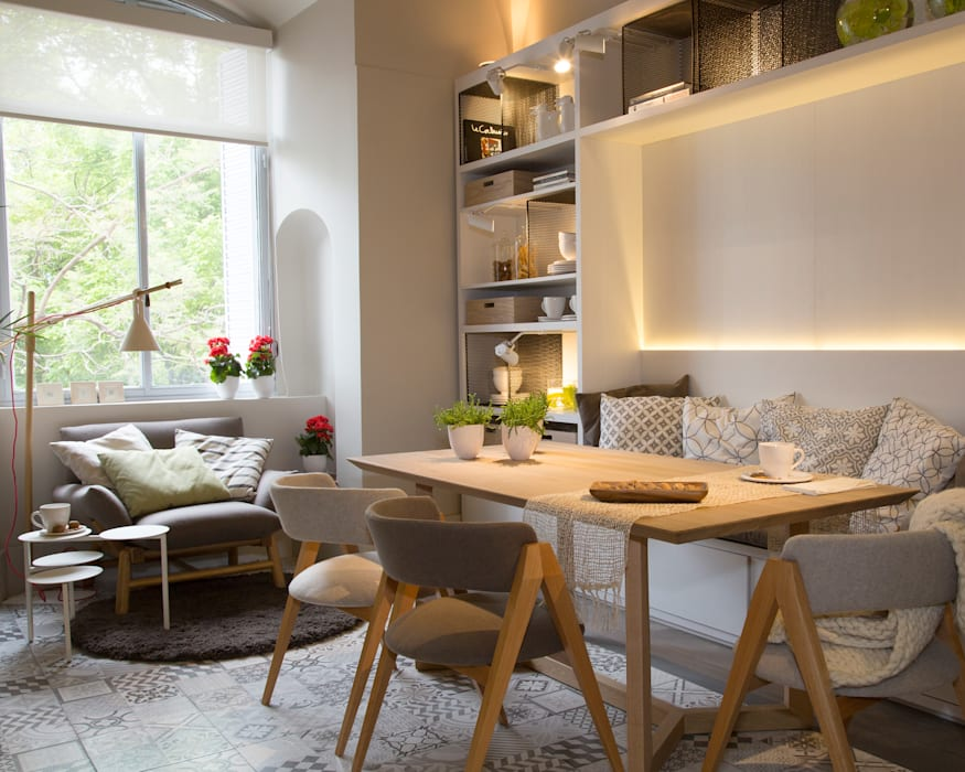 Dining room by Estudio de iluminación Giuliana Nieva,