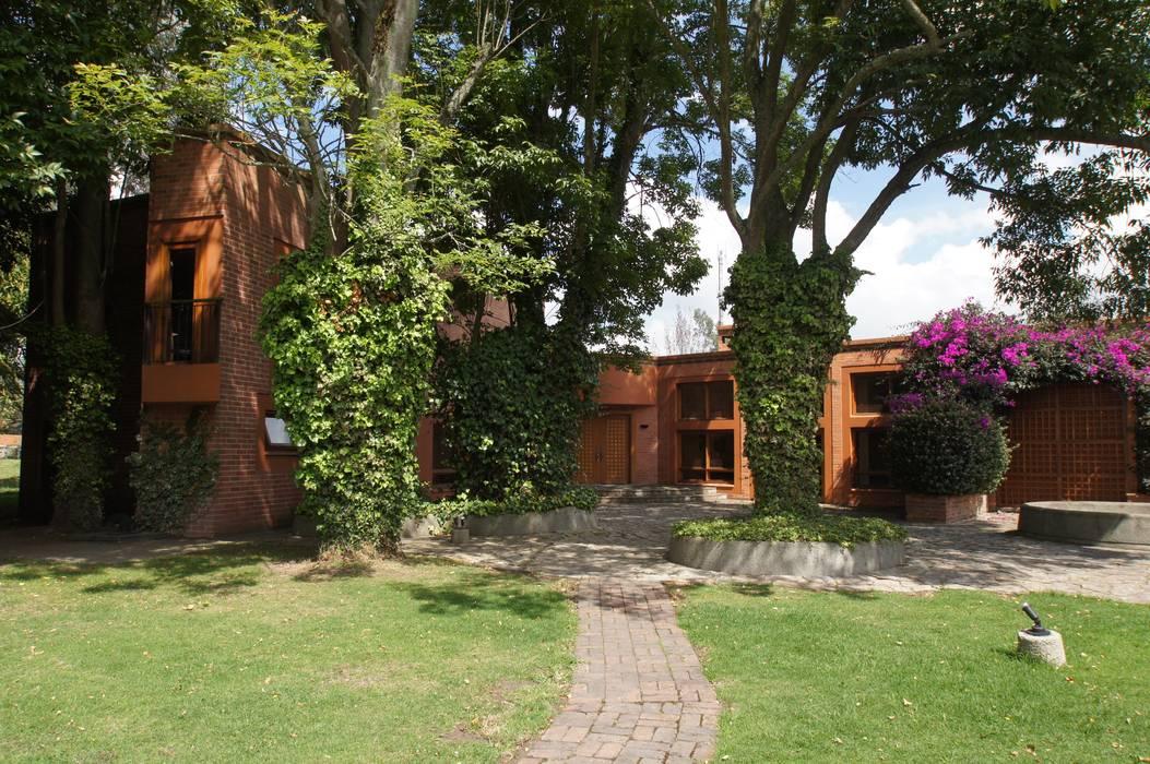 Vivienda Sandquist: Casas de estilo  por GRUPO CATA