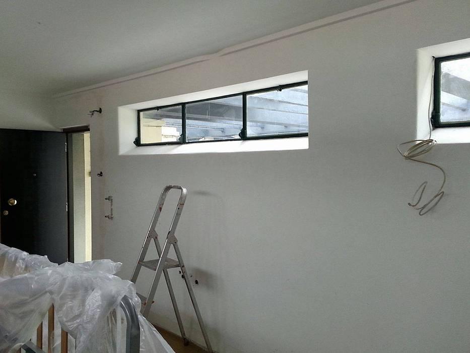 Aplicação de papel de parede! (antes) Hotéis industriais por Pode Ser! Industrial