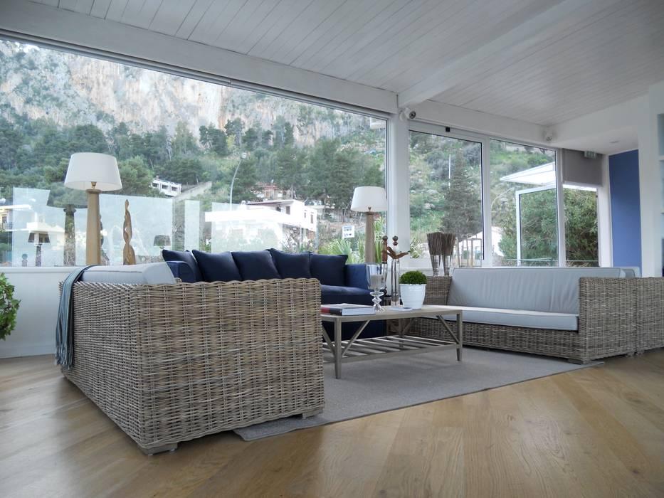 Гостиная в средиземноморском стиле от EXCELSIOR HOME INTERIORS Средиземноморский
