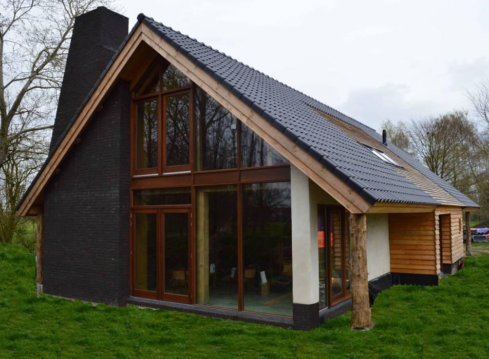 Дома в стиле кантри от STROOM architecten Кантри Камень
