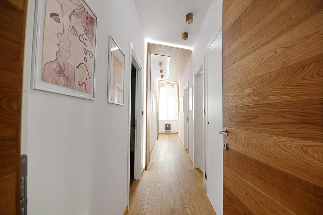 Couloir, entrée, escaliers modernes par homify Moderne Bois Effet bois