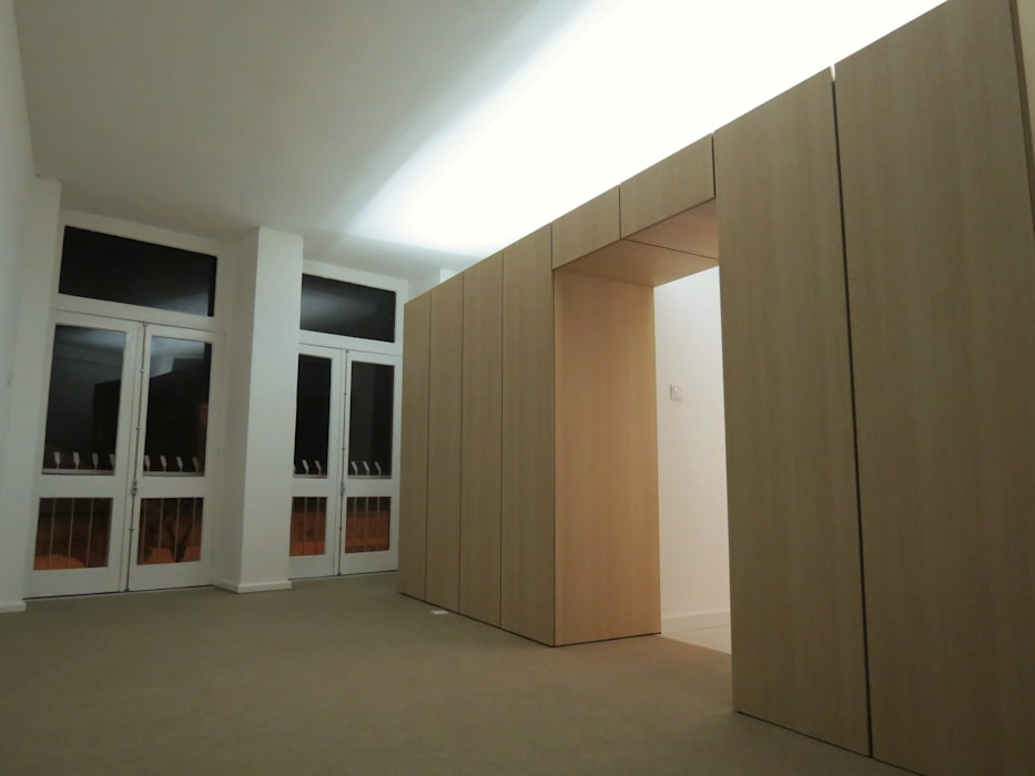 Apartamento T0 : Salas de estar  por Ivo Sampaio Arquitectura