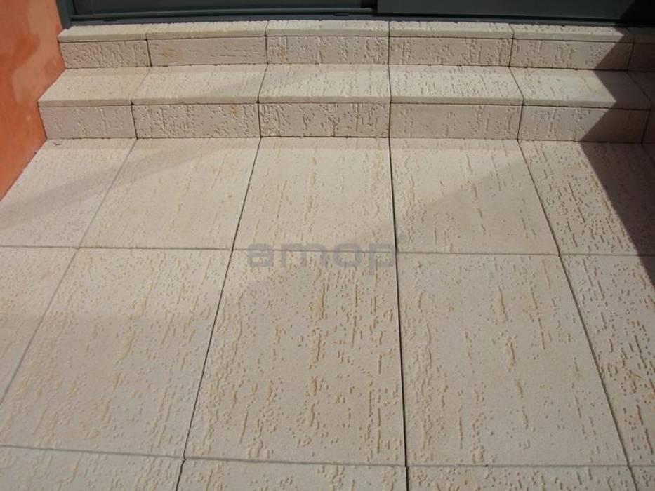 Pedra Mono K, Toskana Paredes e pisos modernos por Amop Moderno