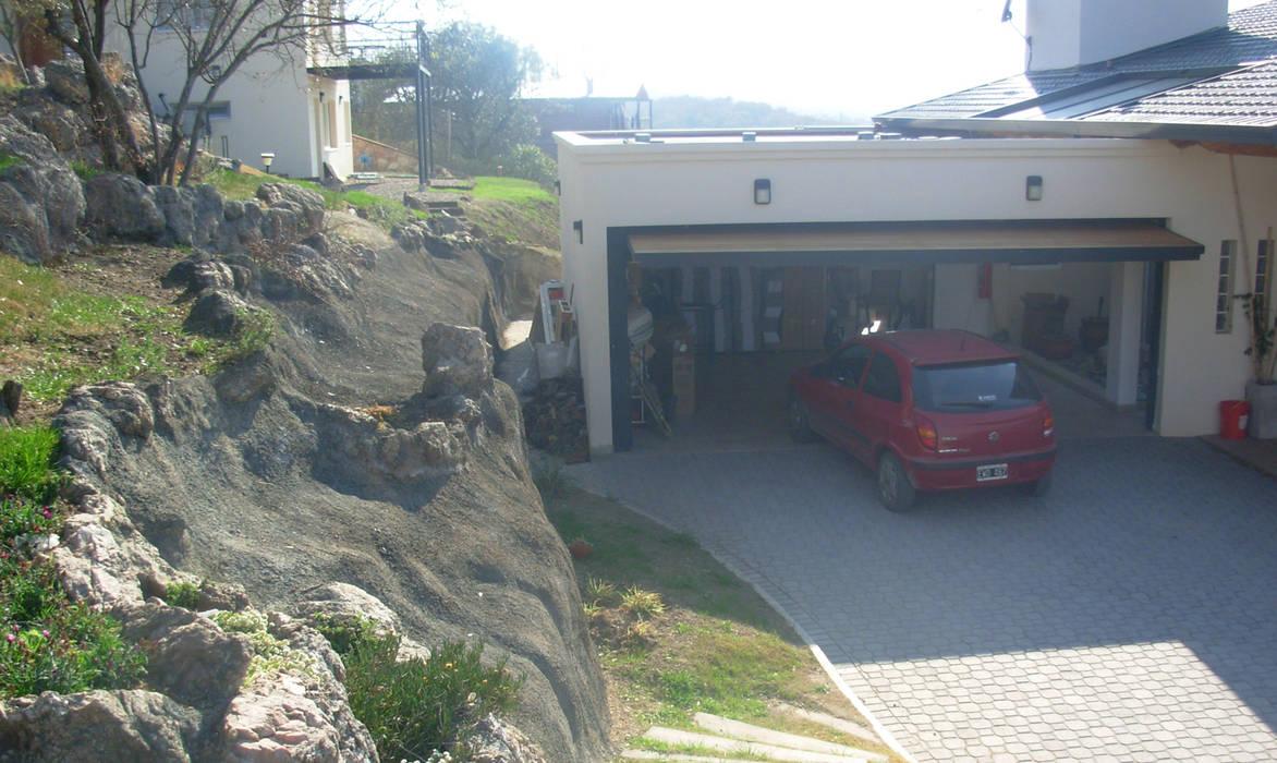 Casa Lago Garajes de estilo moderno de renziravelo Moderno