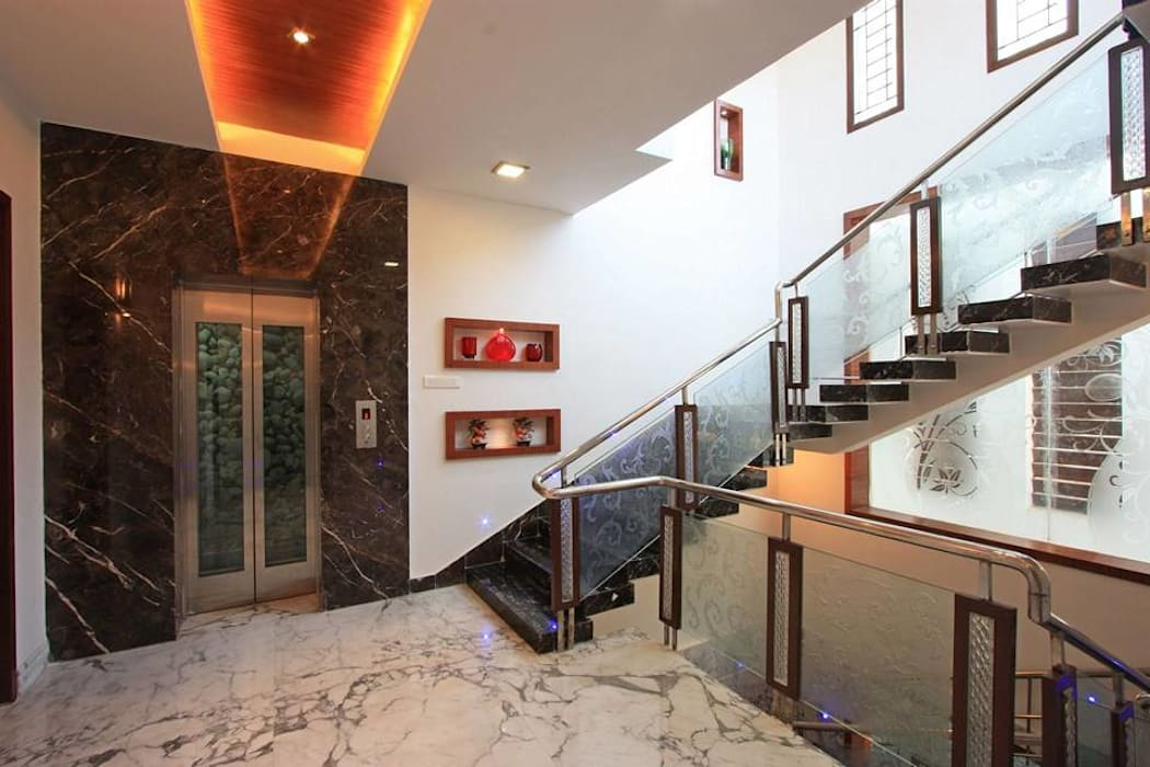 Staircase & lift:  Corridor & hallway by Ansari Architects