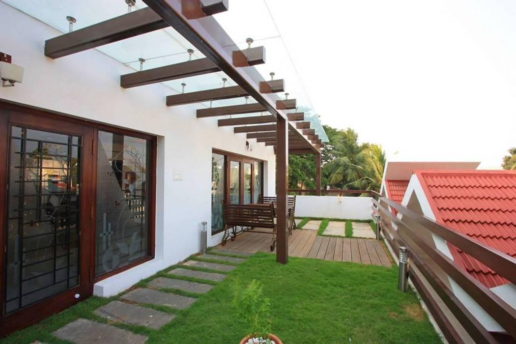 Terrace garden:  Garden by Ansari Architects