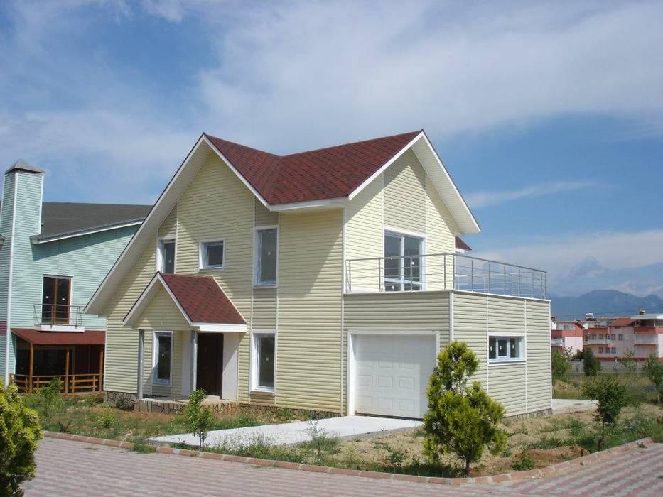 Konutlar Casas de estilo moderno de Murat Kaya Mimarlik Ltd. Sti. Moderno