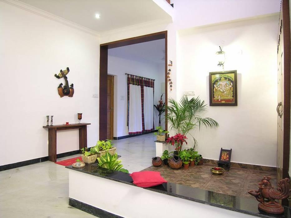 pooja room:  Living room by Ansari Architects
