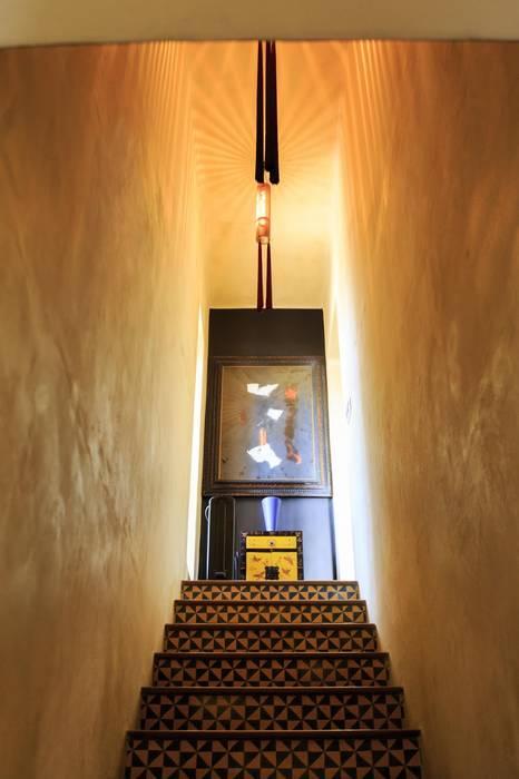Mediterranean corridor, hallway & stairs by Crafted Tiles Mediterranean